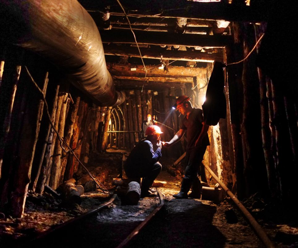 Break: Two miners stop to smoke in a manganese mine above Chiatura