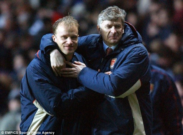 Mentor: The Dutchman and Arsenal manager Arsene Wenger embrace back in 2002