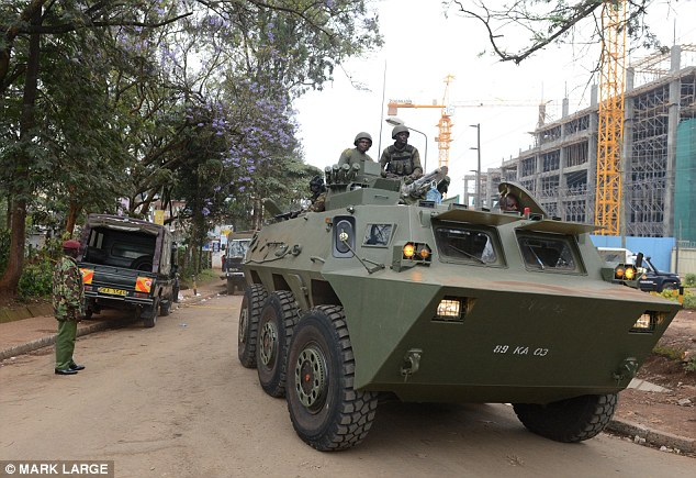 Leaving: Kenyan Defence Force soldiers move away from the Westgate mall after the siege ended