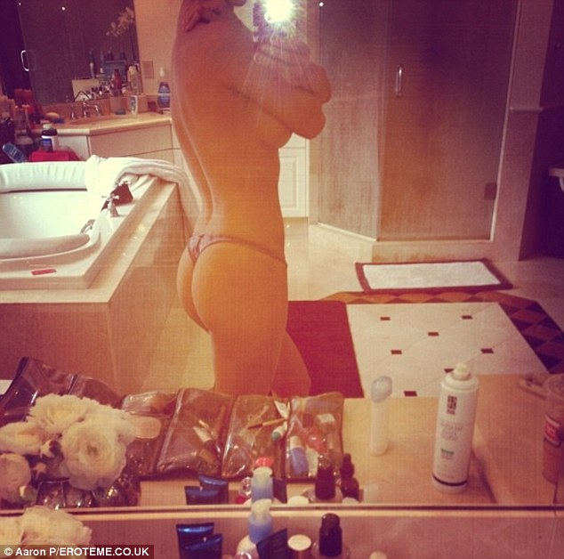 Not exactly shy: The 34-year-old stunner shared a selfie on Monday and a generous view of her pert derriere and side boob