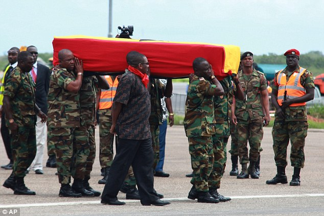 In mourning: Ghanaian soldiers carry the flag-draped coffin of celebrated poet, professor and ambassador Kofi Awoonor after his body was flown back from Kenya, at the airport in Accra, Ghana