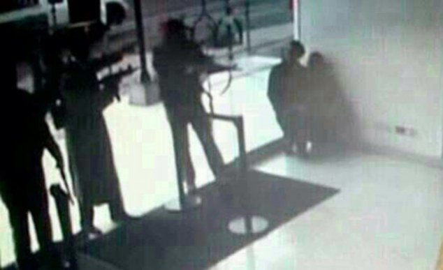 Sinister shadows: A CCTV image shows three armed terrorists entering a bank in the Nairobi shopping centre