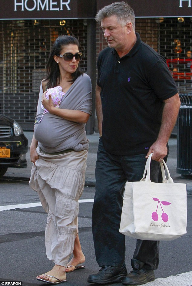 Looking mellow: Baldwin took a break from his usual fiery outbursts on Friday as he accompanied wife Hilaria and their newborn daughter to breakfast