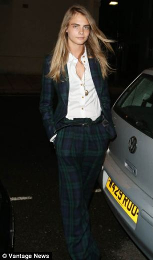 Image result for image of Theresa May in tartan suit