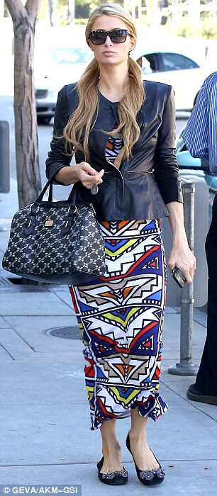 Not falling for Fall: The heiress donned a colourful tribal patterned maxi dress with a peplum cut black leather jacket, a pair of flats with bows on them, and a bag from her own accessories line