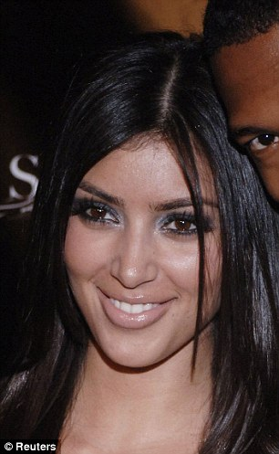 Version one: Kim with Nick Cannon in 2006