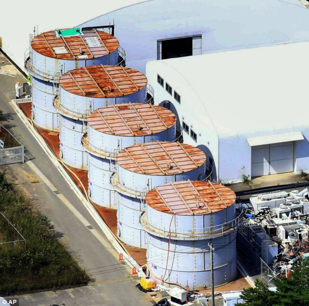 Danger: The operator of the meltdown-plagued plant says at least 430 litres spilled when workers overfilled a storage tank that lacked a gauge that could have warned them of the danger