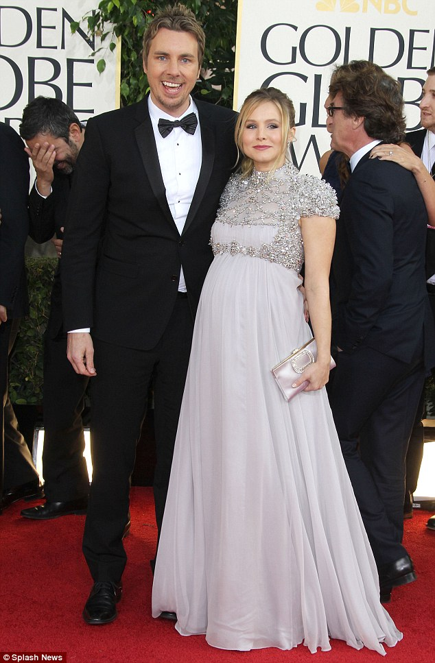 Happy couple! A heavily pregnant Kristen and partner Dax Shephard pose at the Golden Globes in January 2013