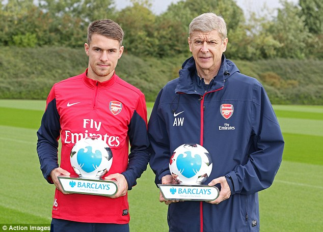 Double recognition: Ramsey and Wenger are presented with their awards at Arsenal's London Colney training ground