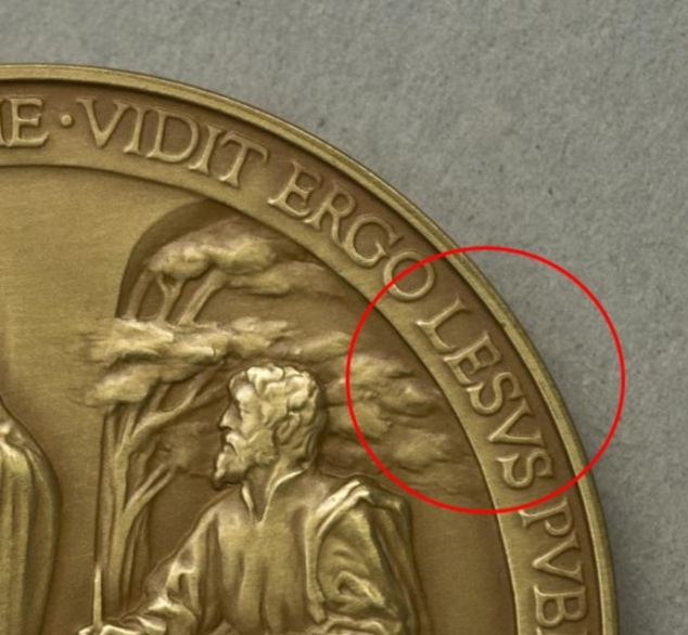 An official medal celebrating the first year of Pope Francis's reign has gone on sale with a spelling mistake in Jesus's name