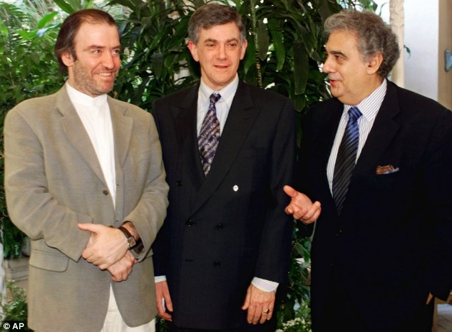 Stolen gift: Alberto Vilar, center, poses with tenor and artistic director of the Los Angeles Opera, Placido Domingo, right, and Valery Gergiev, of Russia's Mariinsky Opera and Ballet, as they announce Vilar's multi-milion gift to the operas in 2000