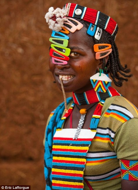 Colourful: One of the girls shows off her collection of beads and clips