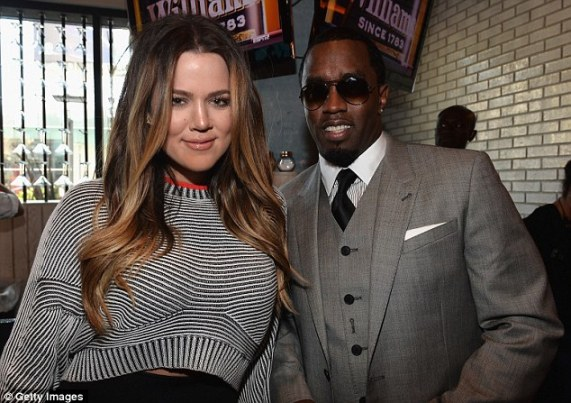 Cozying up to Daddy: The reality star was sure to a get a memento with Sean Combs