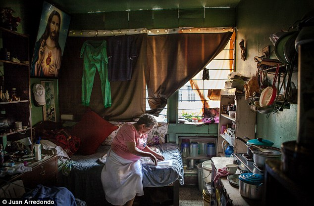 Home: Carmen Salgado, 67, has been living is this room for 17 years. She pays $6.50 a day in rent