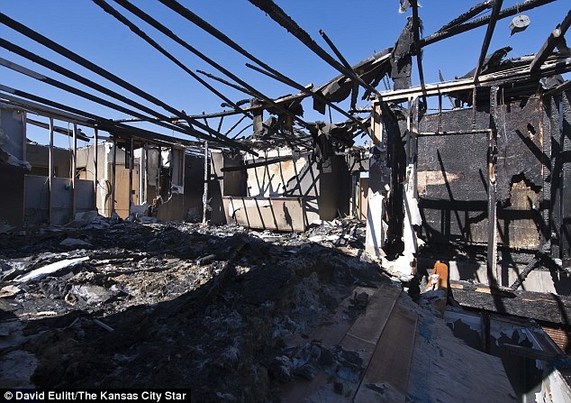 Remains of the day: The charred skeleton of the Coleman's former family home in Maryville, Missouri. Firefighters were forced to stop investigations into the cause of the blaze when the ruin was deemed unsafe