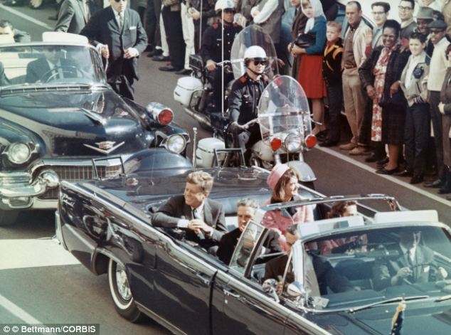 Before tragedy: President John F. Kennedy and his wife Jackie Kennedy Onassis smile at the crowds lining their motorcade route in Dallas, Texas, on November 22, 1963 minutes before he was shot