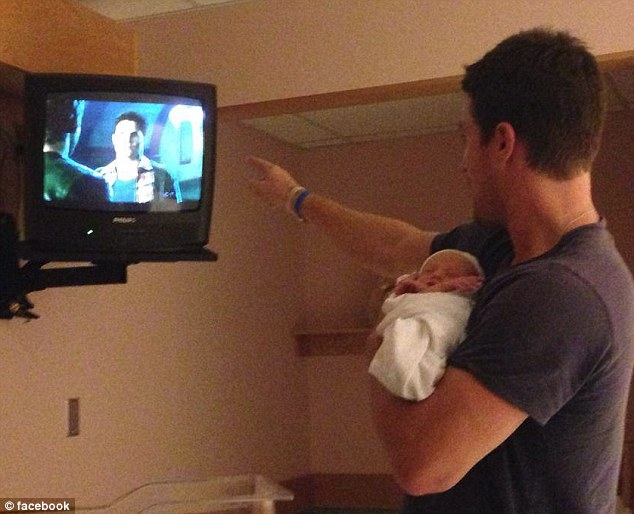 Shoot for the stars: Arrow star Stephen Amell was making his newborn daughter Mavi watch his show in a picture he shared with fans after announcing her birth