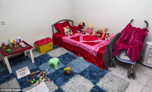 Neat and tidy: The room of the girl understood to be aged four is the only bedroom in her 'family's' house