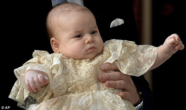 Main man: Prince George, in the arms of his father, was centre of attention in his vintage christening gown