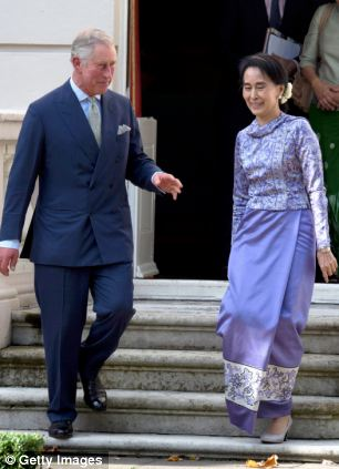 Prince Charles gave the Burmese democracy leader a tour of the gardens during her visit