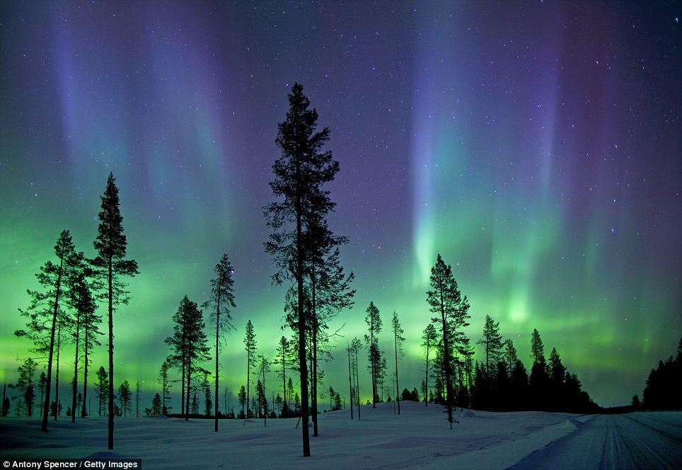 Dancing lights: The unique majesty of Aurora Borealis as photographed in the early morning hours in the arctic circle. Also known as the Northern Lights, these fascinating light shows are at their peak when sunspots occur with the most frequency