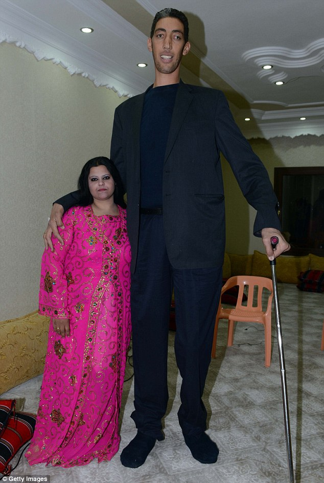 The World's tallest man Sultan Kosen poses with his fiancee Merve Dibo during their henna night, the ceremony held one day before the wedding