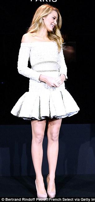Blake Lively Displays Slender Legs In White Mini Dress As