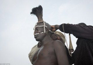 Decoration: The dress code for the ceremony also includes a selection of beautifully worked headdresses, in this case, one made from a mixture of cowrie shells and ostrich plumes