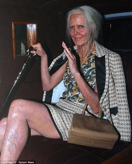 Heidi Klum dressed as an Old woman for Halloween.