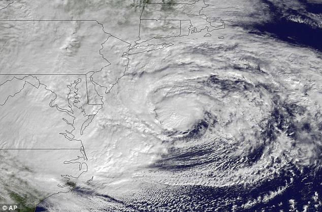 Destruction: Satellite image from October 2012 of Superstorm Sandy on the eastern seaboard. A year after Sandy devastated the East Coast, President Obama signed an order