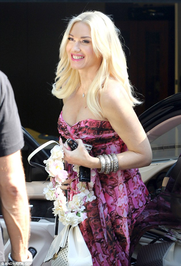 Glowing: The No Doubt singer was glowing as she arrived bearing a flowery wreath