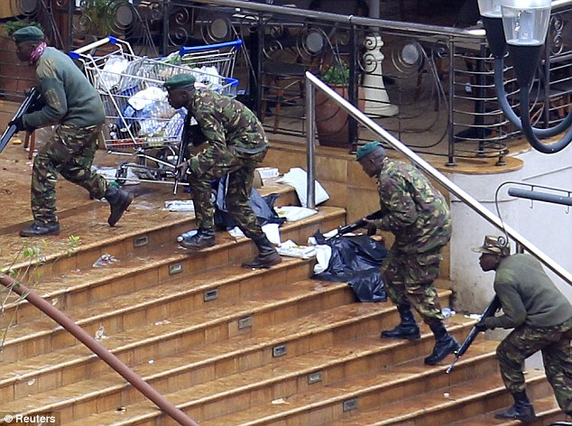 Helpless: Kenya Defence Forces soldiers take their position at the Westgate shopping centre. Storm says he is frustrated knowing he could have prevented the attack