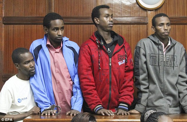 First appearance: Four suspects (left to right) Liban Abdullah Omar, Mohamed Abdi Ahmed, Hussein Hassan and Adan Mohamed Ibrahim stood in the dock today for a hearing at a courtroom in Nairobi accused of playing a part in the Westgate Mall bombing