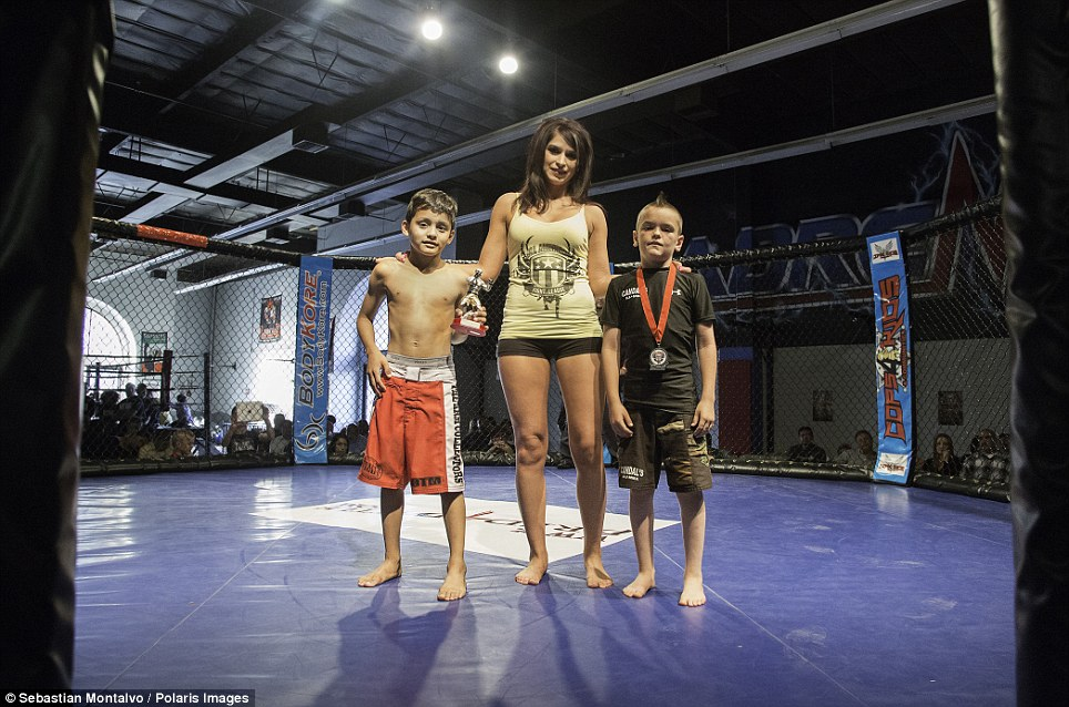 Riverside, California, United States: Kriss Arrey, 7, and Justin Ramirez, 7, receive trophies after winning a Pankration tournament organized by the United States Fight League in Riverside