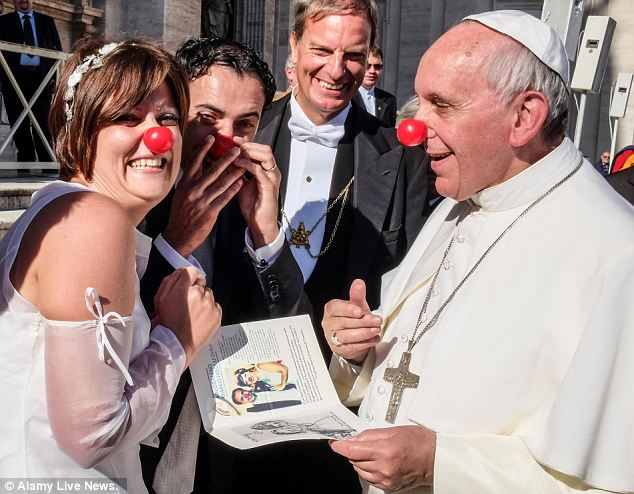 The Pope greeting the newlyweds (who share a clown ministry with children)