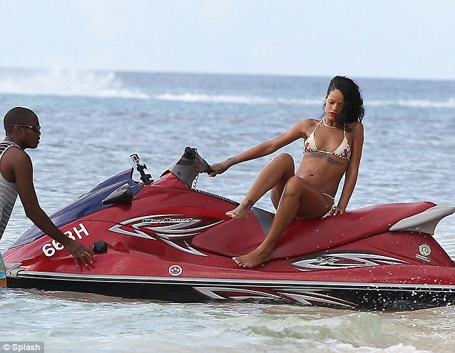 Break time: The Bajan star jumps off the jet ski to relax with her friends