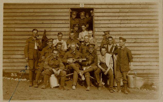 Buried alive: Sergeant Ashby (pictured far left before leaving to fight) was buried in the mine crater mentioned in Harry's 6 June entry