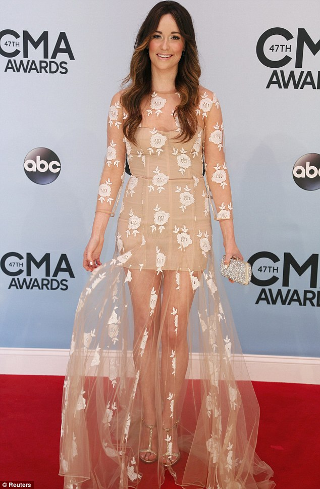 A rose by any name: Newcomer Kacey Musgraves looked angelic in her netted cream dress at the awards show