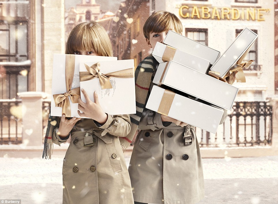 Feel good: The campaign stars rosy-cheeked children kitted out in the iconic Burberry trench coats