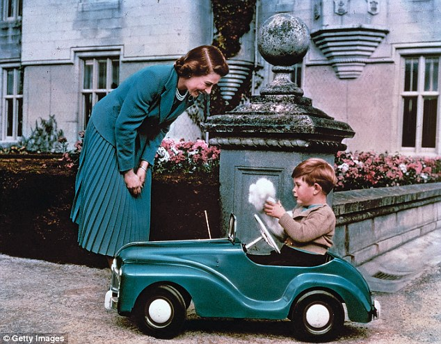 28th September 1952: Princess Elizabeth watching her son Prince Charles playing in his toy car while at Balmoral