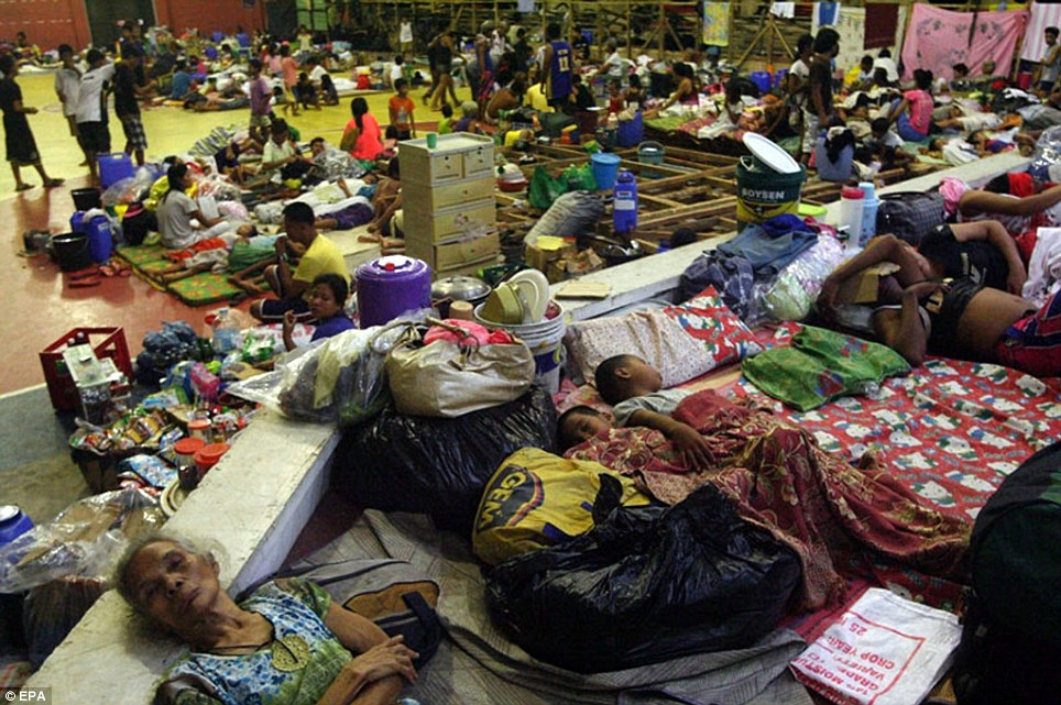 Shelter: Filipino residents sleep on the floor of a gymnasium turned into an evacuation center in Sorsogon City in the Bicol region