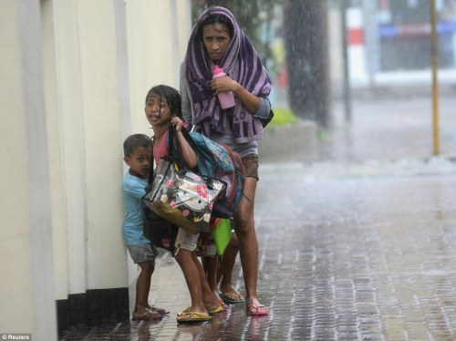 Downpour: As well as strong winds, the typhoon brought with it torrential rain which caused landslides in rural parts of the country