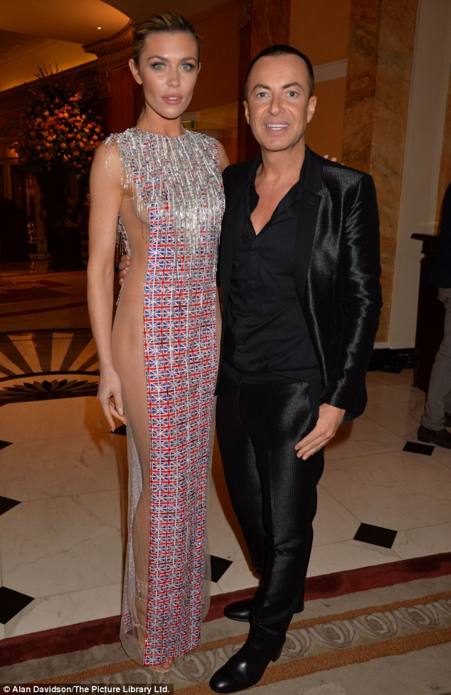 One for the boys: Abbey's dress is a creation by Julien MacDonald, done especially for the event to support British troops at war