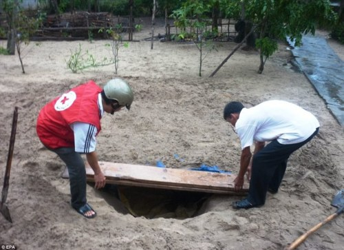 Protection: Local volunteers dig a trench to provide shelter from the typhoon which is heading for mainland Asia