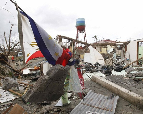 Debris: A Philippine flag lies in the rubble of damaged houses
