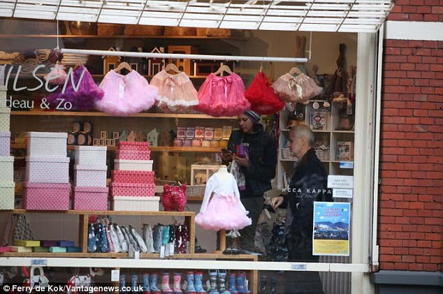 Shopping for little ones: Katy appeared to have checked out a store that sells products for babies