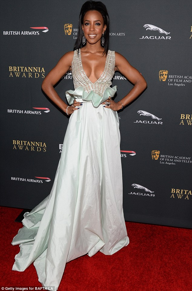 Sexy singer: Kelly Rowland wear a plunging sea-foam green dress to the BAFTA LA Britannia Awards on Saturday