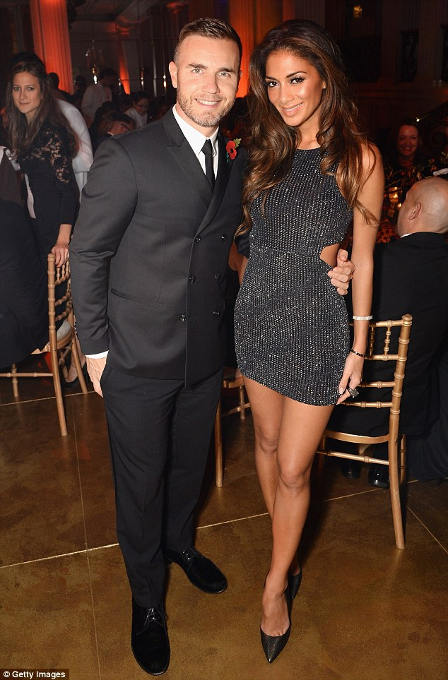 They've got The X Factor: The singer poses with Gary Barlow while sporting a daring mini-dress