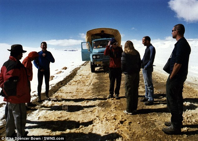 Mike Spencer Bown (front right) pictured on the longest sloping down road in the world from Tibet to Nepal