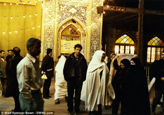 'Most traveled man in history': Mike Spencer Bown pictured in an Islamic shrine in Tehran, Iran, in 2003